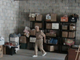 Dr. Ali Manizade helping to move boxes to storage